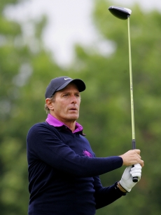 Michael Bolton tees off from the 1st hole during the Shooting Stars in Desert Nights Benefit 2009 Golf Day at The London Golf Club on June 11, 2009 in London, England.