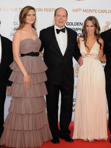 Prince Albert II of Monaco strikes a pose with  Emilie Deschanel and Jennifer Love Hewitt during the closing ceremony of the 2009 Monte Carlo Television Festival on June 11, 2009