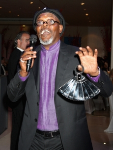 Samuel L. Jackson leads the auction during the Shooting Stars in Desert Nights Benefit 2009 party at the Hurlingham Club on June 11, 2009 in London, England