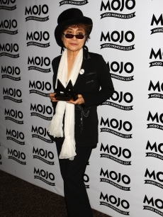 Yoko Ono poses with her Lifetime Achievement award during the 2009 MOJO Honours List at The Brewery on June 11, 2009 in London