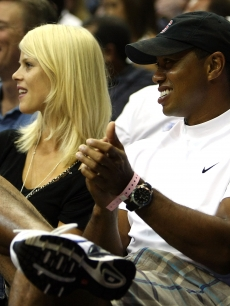 Tiger Woods and wife Elin Nordegren take in the action during game four of the 2009 NBA Finals between the Los Angeles Lakers and the Orlando Magic on June 11, 2009