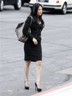 Lucy Liu arrives at the funeral of David Carradine on Saturday June 13, 2009, in Los Angeles