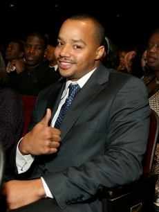 Donald Faison pose for photos in the audience during the 38th annual NAACP Image Awards held at the Shrine Auditorium on March 2, 2007 in Los Angeles, California.