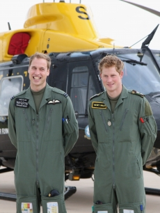 Prince William and Prince Harry show a little brotherly love in front of a Griffin helicopter during a photocall at RAF Shawbury on June 18, 2009 in Shawbury, England