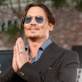 Johnny Depp flashes a grin at the premiere of 'Public Enemies' in Los Angeles on June 23, 2009
