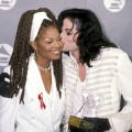 Michael Jackson gives sister Janet Jackson a kiss at the 35th Annual Grammy Awards, Feb. 24, 1993
