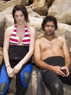Ashley Greene and Adrian Grenier during the Oakley Learn to Ride fueled by Muscle Milk Surf Camp at Carpinteria State Beach in Carpinteria, CA