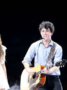 Miley Cyrus and Nick Jonas take the stage at the new Cowboys Stadium on June 20, 2009 in Dallas, Texas
