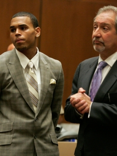 Chris Brown and attorney Mark Geragos appear at a preliminary hearing at Superior Court of Los Angeles County on June 23, 2009 in Los Angeles, California