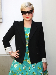 Kelly Osbourne poses backstage prior the Frankie Morello show as part of Milan Menswear Fashion Week Spring/Summer 2010 in Milan, Italy on June 21, 2009