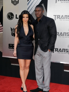 Kim Kardashian and Reggie Bush shine on the red carpet at the premiere of 'Transformers: Revenge Of The Fallen' on June 22, 2009 in Los Angeles