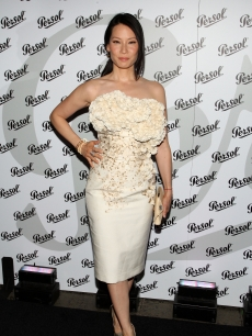Lucy Liu shines in white at the opening night celebration of the Persol 'Incognito Design Exhibition' in New York City on June 23, 2009