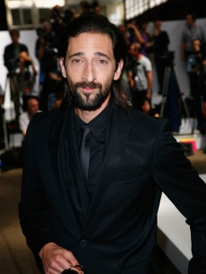 Adrien Brody strikes a pose at the Hugo Boss fashion show in Paris on June 25 2009