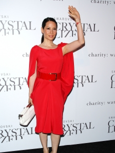Lucy Liu waves on the red carpet at the Swarovski Crystallized Concept store grand opening in New York City on June 25, 2009