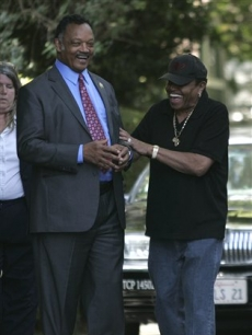 Rev. Jesse Jackson and Joe Jackson share a light moment outside the Jackson family home in the Encino neighborhood of Los Angeles on June 26, 2009