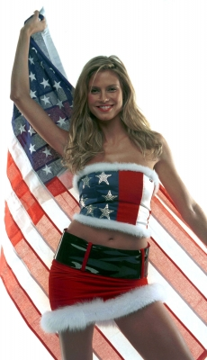 Heidi Klum wears Patriotic Santa Suit designed by Tommy Hilfiger