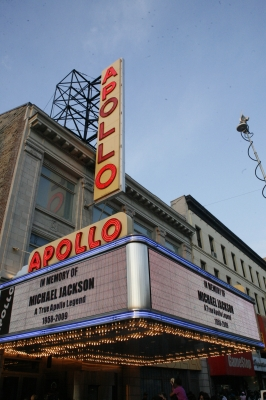The Apollo Theater's marquee memorializes pop star Michael Jackson as crowds of fans gather outside to remember him on June 25, 2009 in New York City