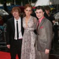 Rupert Grint, Emma Watson and Daniel Radcliffe brave the rain at the world premiere of &#8216;Harry Potter and the Half Blood Prince&#8217; in London on July 7, 2009 