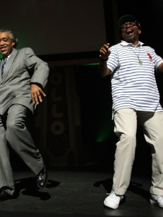 Reverend Al Sharpton and Spike Lee bust a move onstage during a public memorial for Michael Jackson at The Apollo Theater in New York City on June 30, 2009