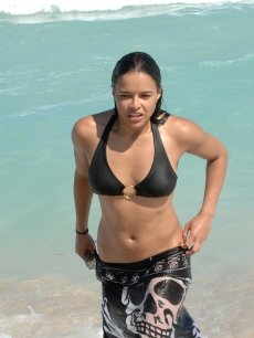 Michelle Rodriguez walks out of the ocean on South Beach in Miami Beach, Florida
