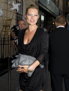 Kate Moss pauses for a photo on her way to the Beth Ditto For Evans at Sketch event in London, England on July 1, 2009