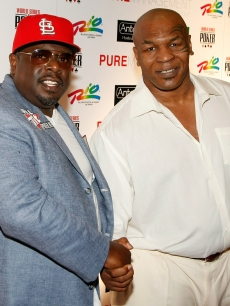 Comedian Cedric the Entertainer and Mike Tyson strike a pose at the &#8216;Ante Up for Africa&#8217; celebrity poker tournament in Las Vegas on July 2, 2009 