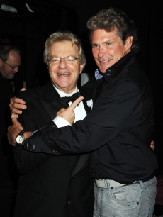 Jerry Springer and David Hasselhoff share a hug during &#8216;Chicago&#8217; at the Cambridge Theatre in London on July 2, 2009 