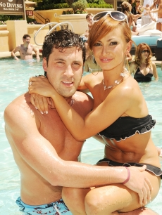 Maksim Chmerkovskiy and Karina Smirnoff pose poolside at The Venetian Hotel and Casino Resort in Las Vegas, July 4, 2009