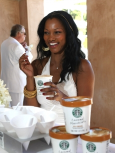 Garcelle Beauvais-Nilon chows down during Diddy's annual White Party for Malaria No More in LA on July 4, 2009