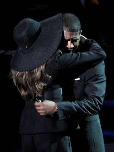 Usher hugs LaToya Jackson after an emotional performance at the Michael Jackson public memorial service held at Staples Center on July 7, 2009 in Los Angeles