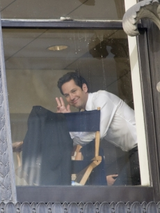 Paul Rudd smiles as he waves from a window in Philadelphia on July 7, 2009 