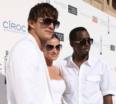 Ashton Kutcher, Demi Moore and Sean 'Diddy' Combs at the annual White Party in LA on July 4, 2009