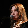 Carla Bruni-Sarkozy performs at the dress rehearsal for Mandela Day, a celebration of Nelson Mandela, at Radio Music Hall in New York City on July 18, 2009