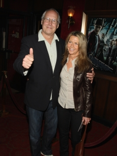 Chevy Chase and guest hit the red carpet for the New York premiere of 'Harry Potter and the Half-Blood Prince' on July 9, 2009