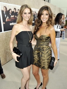Kelly Kruger and Jamie-Lynn Sigler strike a pose on the red carpet at the premiere of HBO's 'Entourage' - Season 6 in Los Angeles on July 9, 2009