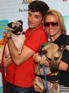 'Ugly Betty' stars Michael Urie and Becki Newton pose at the 11th Annual Broadway Barks event in Shubert Theatre in New York City on July 11, 2009
