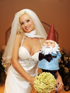 Holly Madison ties the knot with the Travelocity gnome at The Wedding Chapel at Planet Hollywood in Las Vegas on July 12, 2009