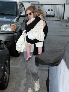 Isla Fisher with daughter Olive Cohen spotted at LAX on July 13, 2009 in Los Angeles