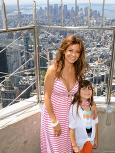 Brooke Burke and daughter Sierra smile atop the Empire State Building in New York City on July 14, 2009