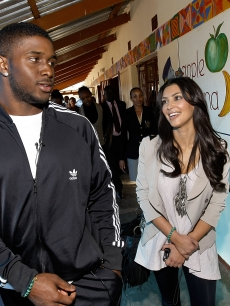 Kim Kardashian and boyfriend Reggie Bush pay a visit to the Motswedi Rehabilitation Centre during a Diamond Empowerment Fund tour of Africa in Mochudi, Botswana on July 14, 2009 