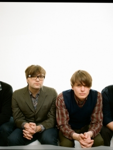 The Death Cab For Cutie dudes pose for a portrait