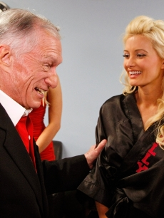 Hugh Hefner and ex Holly Madison share a moment after her perofrmance in 'Peepshow' at Planet Hollywood in Las Vegas on July 18, 2009