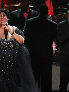Josh Groban and Aretha Franklin take the stage during the Mandela Day Celebration Concert at Radio City Music Hall in New York City on July 18, 2009