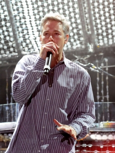 Adam Yauch — aka MCA — of The Beastie Boys rocks the mic during Bonnaroo 2009 in Tennessee