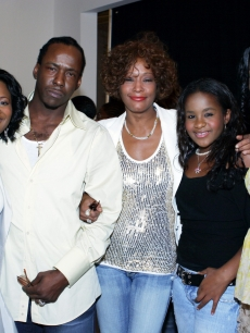 Whitney Houston, Bobby Brown, daughter Bobbi Kristina, and executive producers at the &#8220;Being Bobby Brown&#8221; premiere on June 27, 2005