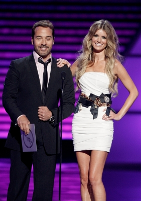 Jeremy Piven and model Marisa Miller share a laugh onstage during the 2009 ESPY Awards in LA on July 15, 2009 