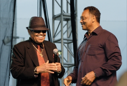 Michael Jackson's father, Joe Jackson, and the Rev. Jesse Jackson attend a memorial service for Michael Jackson at U.S. Steel Yard ballpark, Gary, Indiana, July 10, 2009