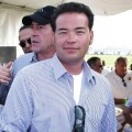 Jon Gosselin poses for a picture with Michael Lohan in the background at the 2009 Mercedes-Benz Polo Challenge in Bridgehampton, New York