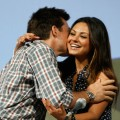 Mila Kunis gets a hug from co-star Jason Bateman at the &#8216;Extract&#8217; panel at San Diego Comic-Con on July 25, 2009