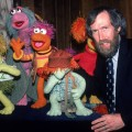 Film & televison director and puppeteer Jim Henson (1936 - 1990) poses with several of his Fraggle Rock muppets, 1983